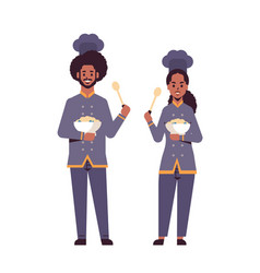 cooks couple professional chefs holding plates vector image