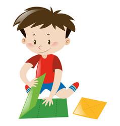 Little boy folding green paper vector