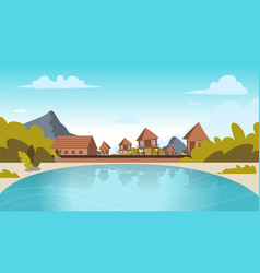 image a village on the shore of a lagoon vector image