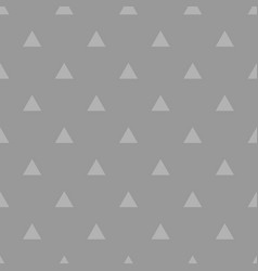 Tile pattern with white triangles on grey vector