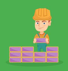 Caucasian bricklayer boy building a brick wall vector