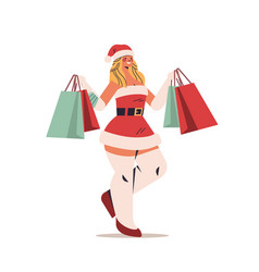 beautiful woman in santa claus costume holding vector image
