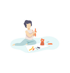 Cute boy sitting on floor and making figures from vector