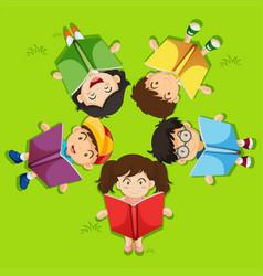 Kids reading book on green grass vector