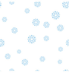 blue snowflakes on a white background seamless vector image