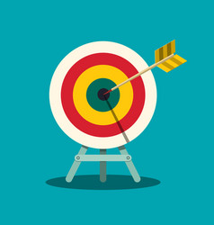 Archery target arrow in centre of bullseye goal vector