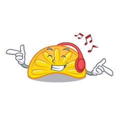 Listening music orange jelly candy mascot cartoon vector