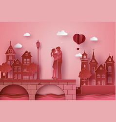 A couple standing hugging the seaside village vector