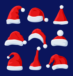 Red santa claus hat set isolated on blue vector