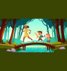 hikers walk over bridge crossing river in forest vector image