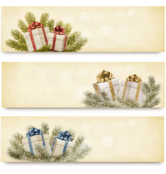 Three christmas banners with gift boxes and vector