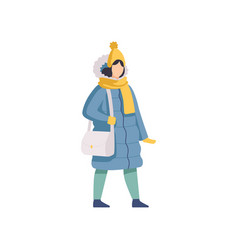 girl walking wearing winter clothes vector image