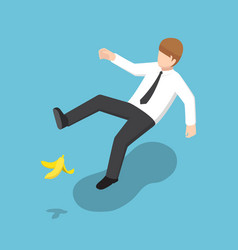 Isometric businessman slipped on a banana peel vector