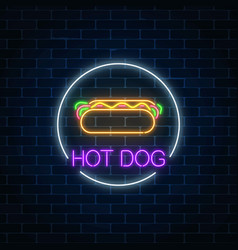 Neon glowing sign of hot dog in circle frame on a vector
