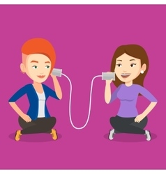 Young friends talking through tin phone vector image vector image