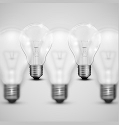 Realistic light bulbs with blurred ones vector