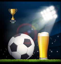 Soccer ball and a glass of beer in the stadium vector