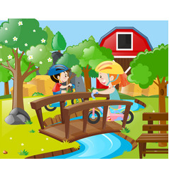 two kids riding bike in the farm vector image