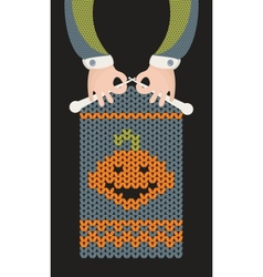 Man is knitting pumpkin vector image