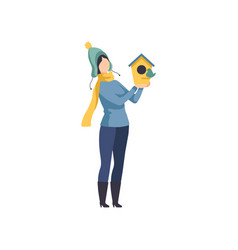 woman holding a birdhouse girl taking care of the vector image