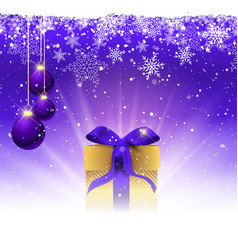 Christmas gift with purple ribbon nestled in snow vector