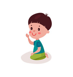 cute dark haired little boy sitting on the floor vector image