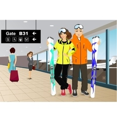 happy couple skiers standing in the airport vector image