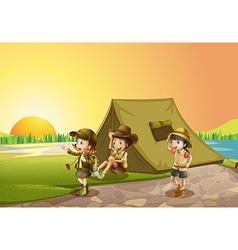 Thee kids camping out in the field vector image vector image