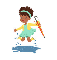 cute little girl holding colorful umbrella and vector image