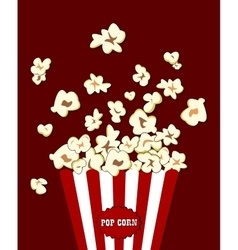 Popcorn exploding inside the red white striped vector image