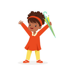 Cute happy black little girl standing and holding vector