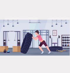sports woman flipping a tire doing hard exercises vector image