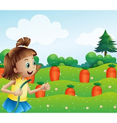 A happy girl watering the carrots in the farm vector image