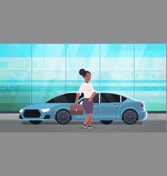 businesswoman standing near luxury car african vector image