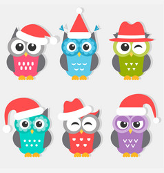 Icons of cute owls with christmas hats vector