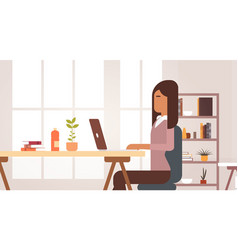 Indian business woman sitting desk working laptop vector