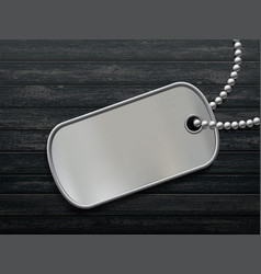 Military metal id tag on a black wooden background vector