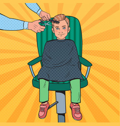 Pop art young boy getting a haircut barber shop vector