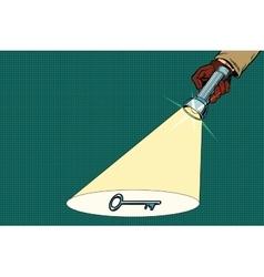 Detective flashlight beam shines on key vector