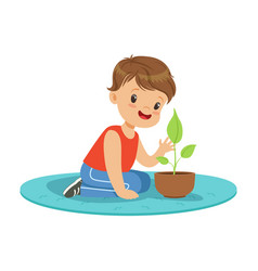 Cute little boy at a practical biology lesson vector