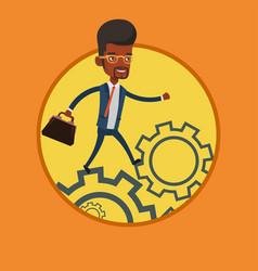 business man running on cogwheels vector image vector image