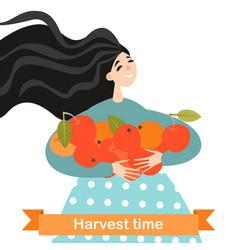 Happy girl is holding ripe apples in hands vector