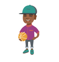 Laughing schoolboy holding a basketball ball vector