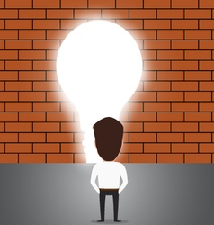 Businessman breaking trough a wall with idea vector