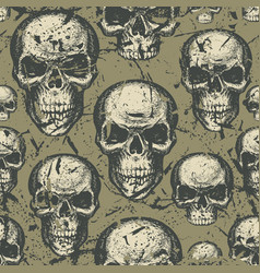 Seamless background with hand drawn human skulls vector