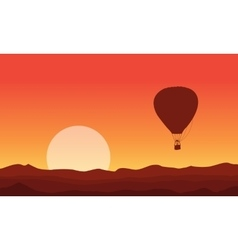 Silhouette of air balloon at sunset vector