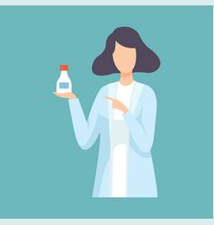 female pharmacist doctor holding medicine bottle vector image