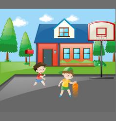 two boys playing basketball at home vector image