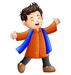 Happy boy in orange winter clothes vector