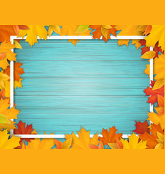 autumn leaves and frame on old wooden background vector image